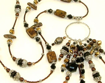 MAJOR MARKDOWN - Dramatic Black and Brown 10 Tasseled Hoop Center Piece on Fully Beaded Bronzite Statement Necklace
