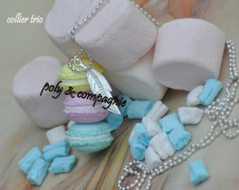 Necklace feather and three macarons in pastel colors