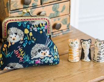 Hedgehog purse - a frame coin purse featuring super cute hedghogs in brightly coloured cotton fabric, large enough to carry cards and cash
