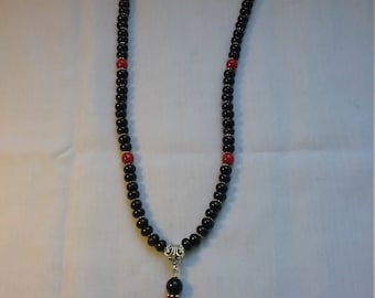 The Ladybug Necklace.  Glass pearls in red and black.