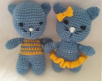 Boy and girl hand crochet cats