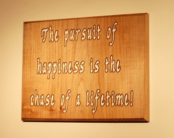 The pursuit of happiness is the chase of a lifetime! - Hand painted solid stock wood plaque - 10118