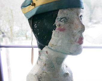 antique bellboy hat
