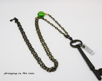 Vintage Skeleton Key Necklace, embellished with vintage green glass crystal and metal tag number 5  No. 88
