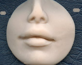 "Polymer Clay  1 1/4""   Side drilled  Fleshtone Nose and lips face Shard FLRDLT 2"
