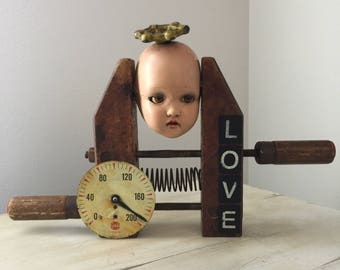 Assemblage art altered dollhead unbreakable found objects