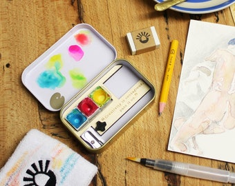 The Sketching Tin plus all colourways by Joan of Art. Everything you need to sketch and paint on the go in a pocket sized tin!