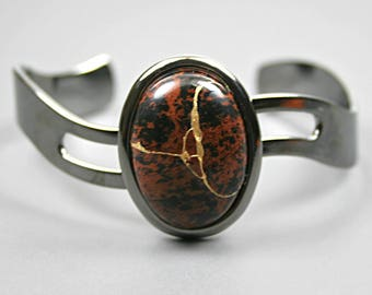 Kintsugi (kintsukuroi) cuff bracelet with mahogany obsidian stone cabochon with gold repair in a gunmetal black plated setting - OOAK