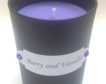 Intense Berry and Vanilla scented candle in a black jar
