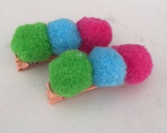 Girls x2 Pom pom hair clips in pink, green and blue.