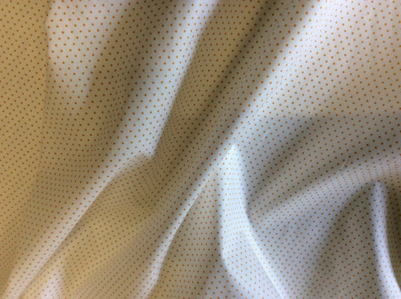High quality cotton poplin printed in Japan, 1mm mustard polka dots