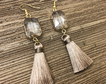 Taupe silky tassle earrings with gold bezel crystals. Tassel earrings