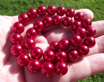 4 RED 10 MM.* ROUND SHELL BEADS