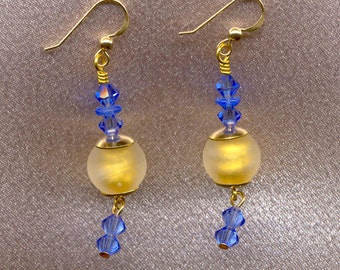 "Venetian Bead Earrings, 24 Karat Gold Foil & Crystal ""Satinato"" finished beads; accented with blue Swarovski crystals."