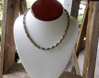 Magnetic silver and gold tone choker