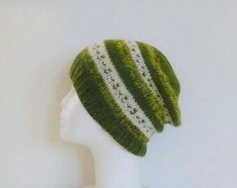 Man in ecru and green alpaca wool hat, hand knitted