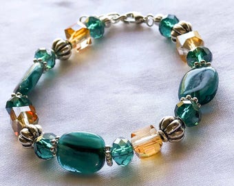 7-8in Aqua and orange glass beaded bracelet