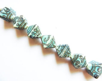 SILVERED COPPER TRIBE    7 copper green and silvered ivory matte finish crystals   A Beaded Gift
