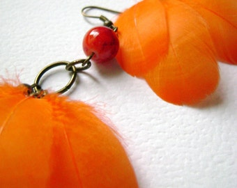 Bohemian feather orange earrings boho chic - Savage style - jewelry desing with orange feathers and glass beads unique long earrings