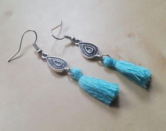 Earrings with light blue tassel