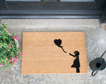 Banksy-style Girl with Balloons quirky doormat - 60x40cm