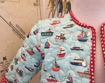 Quilted baby jacket, sail boat print