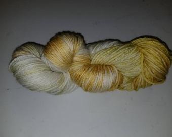 "Gem, a hand-dyed superwash merino wool/nylon blend sport weight yarn. 274yds/100gms/hank. 6sts=1"" on #3-5 needles."