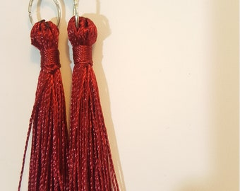 Red boheme tassle earrings with turquoise gemstones.