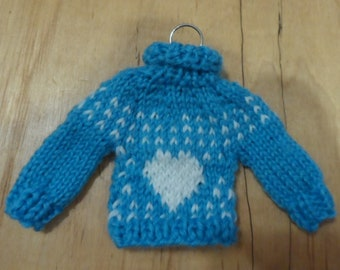 Tiny hand knit sweater ornament on silver hanger