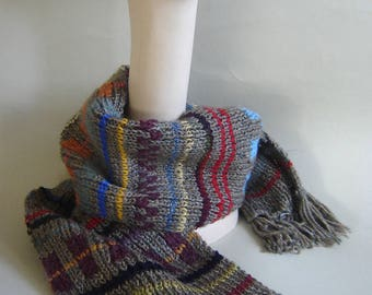 Wonderful hand knitted mixed yarn scarf tweed background