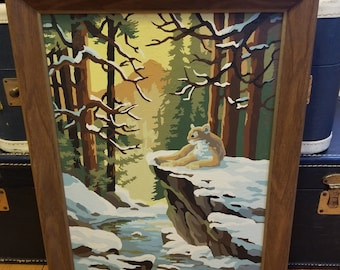 Vintage paint by numbers Snowy wood scene with mountain lion.