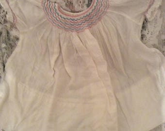 """Vintage Handmade BluePinkSmockedBabyDoll White Dress Appears to Fit a 5 Year Old Has a 5"""" Hem See Full Description For Explanation of Photos"""