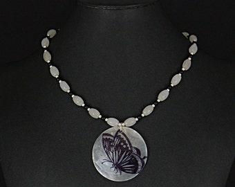 Detailed butterfly shell necklace with snow quartz and onyx gemstone beads by Sylvan Creations.