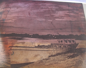 A nice old vintage copper engraving etching printing plate of a boat on a river shoreline