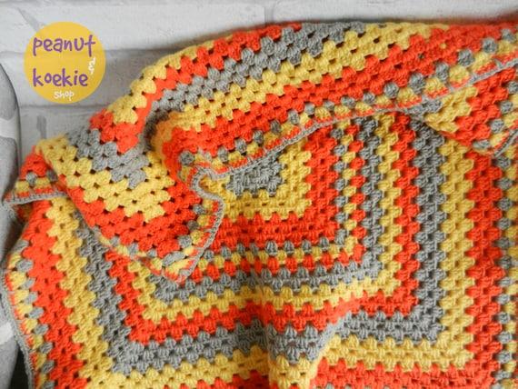 Häkeln Sie Oma Platz Decke in den Farben gelb orange und