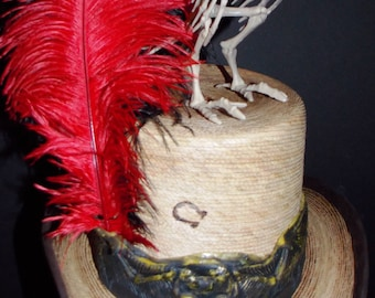 Boney Bird Top Hat.Gothic hat band and a leather-brass hat band under the gothic.red-black feathers.plastic bird,one of a kind,size large.