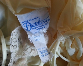 Yellow Camisole made by Dutchess Underwear. Size 9. 100% Nylon.