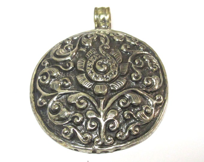 Tibetan antiqued silver finish  repousse Flower pendant with reverse side carving Nepal  - PM351H