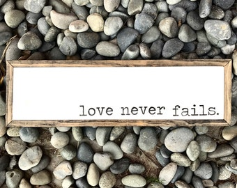 Love Never Fails sign wood sign