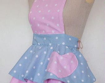 Personalised handmade childrens apron in pastel polkadot fabric.