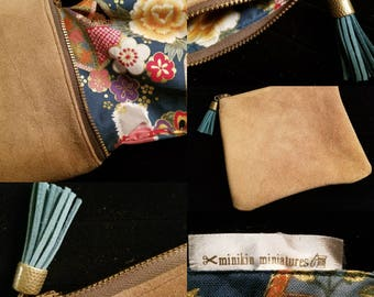 Suede zipper pouch with interlining and tassel