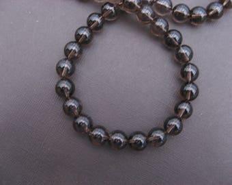 Smoky quartz: 5 round beads 10 mm.