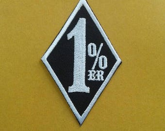 Brodé 1 % ER fer sur patch.