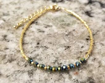 Delicate green jewel-toned beaded bracelet