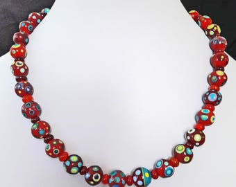 Glowing celebration lampwork bead necklace with handmade sterling silver clasp