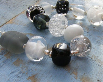 Monochrome lampwork glass bead set of 12 black and white and grey / gray renegade orphan beads