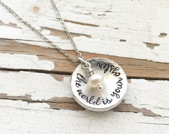 Hand stamped the world is your oyster necklace handstamped wire wrapped fresh water pearl follow your arrow wherever it points wanderlust