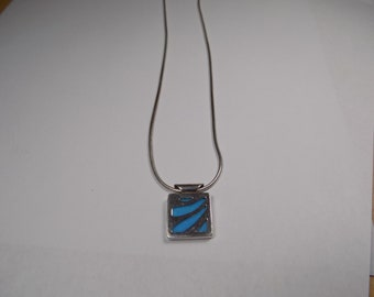 Beautiful sterling silver pendant and 16 inch silver necklace