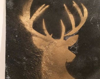 Gold stag on slate