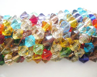 Beads bicone faceted glass 9 x 8 mm x 42
